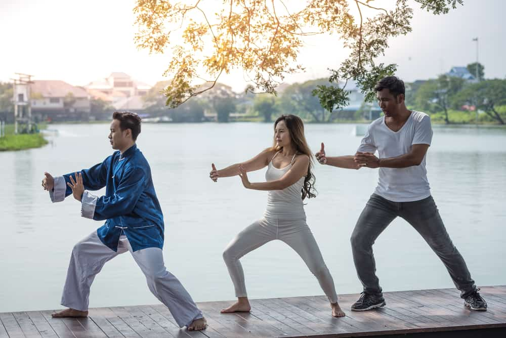 Group of young people Tai Chi Chuan
