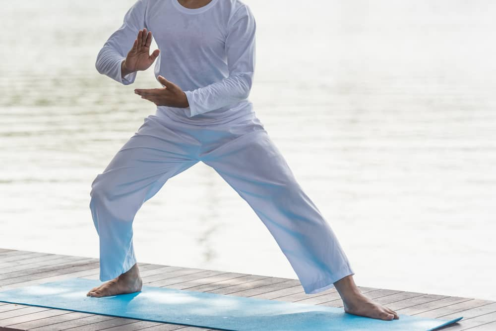 Young man practicing traditional Chinese Tai Chi